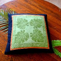 Hand printed monsteria leaf  linen cushion cover from hand carved wooden stamps .