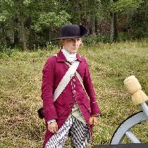 My 18th century gentleman's frockcoat in Wildcherry heavyweight linen. It wears beautifully!