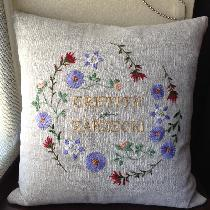 I embroidered this wreath of wildflowers as a wedding gift for my cousin, using cotton and silk...