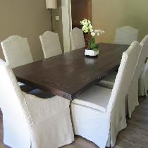 6 dining chairs along with 2 captain chairs (wood arms) were covered in Mixed Natural Softened L...