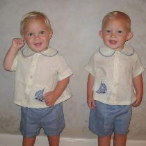 My precious twin grandsons look so handsome celebrating their first birthday in the diaper shirt...
