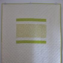 This crib or lap quilt uses handkerchief linen in natural and small patches of Japanese import f...