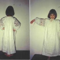 This is a medium weight white linen Russian Rubakha or underdress. It was hand sewn with silk th...