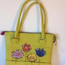 Purse made with warm olive ,lined with purple wine. Machine embroidered.