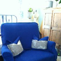 1920 settee slipcovered in 4C22 Rustic Bortovka Royal Blue. Pillows inset with L005-Acanthus.