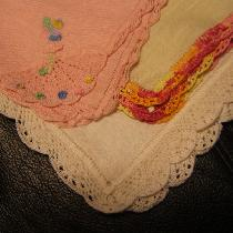 I use the light weight linen and hem stitch hankies by hand, then add a border by tatting or cro...