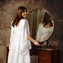 A handkerchief weight 100% linen romantic nightgown. Features a double layered empire bodice, be...