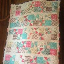 Crib size quilt made for a very special Lady for her baby girl. Free motion quilted it.