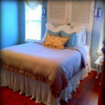 Dust ruffle, duvet cover, shams, and throw pillows (except floral one in front) are all made fro...