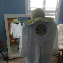 This is a Beach coverup. The linen fabric was a dream to embroidery on. The top has a front zipp...