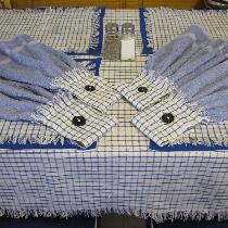 Yarn dyed blue Gingham table cloth, place mats, and hanging dish towels. I used some left over m...