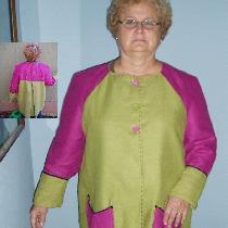 A funky green and pink linen jacket, lined in linen, trimmed with hand embroidered yoke, cuffs,...