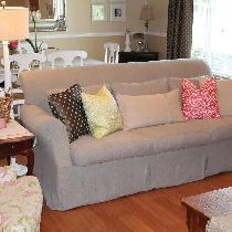 I loved the style of our down filled sofa, but not the fabric.  I made a slipcover from the Heav...