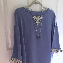 Linen tunic with handmade crochet lace at cuffs and neckline.  Made with IL019 in Wisteria.