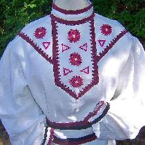 A linen tunic with appliqued and hand embroidered yoke