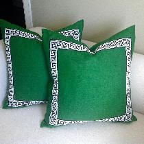 Custom emerald green pillow accented with black and white greek key trim!