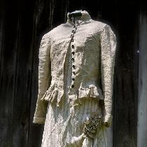 Mix natural jacket with hand pleated ruffle, striped linen over dress, handkerchief linen under...