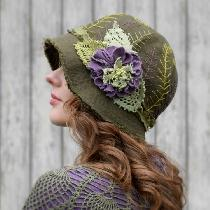 Made from olive green Fabric-store 100% linen and embellished with hand embroidered ferns, a han...