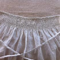This linen apron is all hand sewn and hand smocked. Whipped, horizontal and oblique smocking sti...