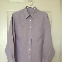 Shirt made from silver lilac lightweight linen with hem stitch detail on the pocket and a deep p...