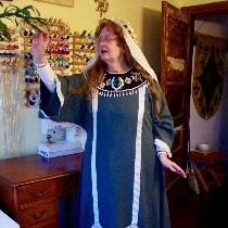 Reenactment of a Byzantine ensemble C. 1100 AD.  The white under tunic is IS003, the gown is Il0...