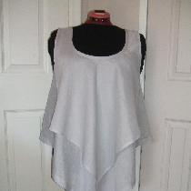A sleeveless tunic in handkerchief linen cut on the bias.