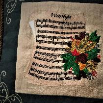 THIS PILLOW COVER IS MADE WITH NATURAL AND EMERALD LINEN, EMBROIDERED SHEET MUSIC,SILVER EMBELLI...