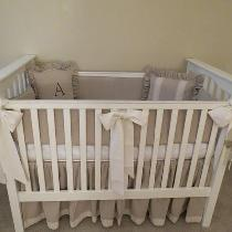 Neutral crib set, (will it be a boy, or a girl?) including crib skirt, bumpers and decorative pi...