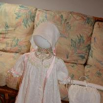Classic smocked bishop baby gown with scalloped pinstitched hem, with matching bonnet and knicke...