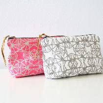 I screen printed and sewed these linen makeup bags by hand. They are available in my shop Satche...