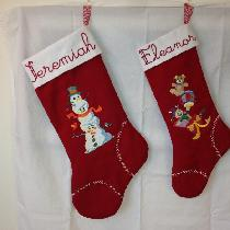 Christmas stockings made with crimson red and optic white. Machine embroidered and added crystal...