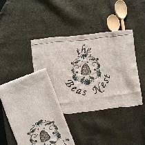 For the bride's gift I machine embroidered on the pocket and towel.  The apron is Teak medium we...