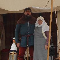 14th Century.  The lady  wears a 7 oz linen tunic, surcoat with rabbit fur trim in 7 oz linen....