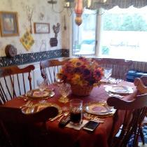 Very simple tablecloth but I thought it was glorious with the fall colors of the centerpiece. Th...