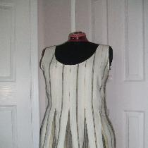 Yarn dyed stripe linen tunic with box pleats.