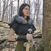 Medieval linen dress in Olive, and fur trimmed hood in black.  By Amy & Lisa Bradley folkoft...