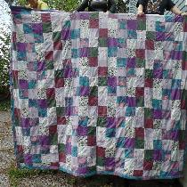 this is one side of the Kings Size quilt I made my granddaughter for her wedding  this year. eve...
