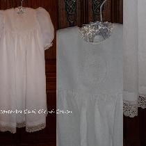 This white handkerchief linen christening gown features a drawn thread whitework cross on the bo...