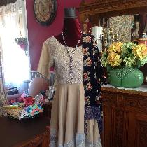 Bias cut dress using linen fabric plus linen and polyester embroidered fabric.. The fabrics drap...