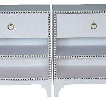 Pair of custom made nightstands wrapped with white linen and accented with nail heads.