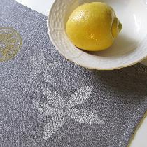 Blockprinted linen teatowel featuring a design of lemon blossoms and sliced lemons. Linen is med...