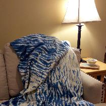 My favorite throw blanket in the spring and beach blanket in the summer.