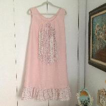 A shabby chic inspired duster using light pink linen embellished with cotton mixed prints rosebu...