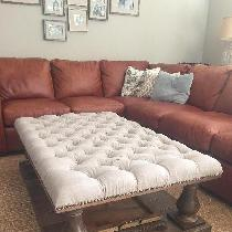 Tufted ottoman using linen IL090 Natural softened. Has a rustic, nubby appearance after washing...