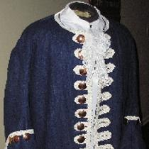 Early-to-mid 18th century, cobalt linen frock coat worn with linen shirt.