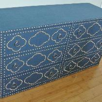 Custom made six drawer dresser wrapped with Blue Bonnet Linen and features a nailhead design.