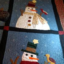 Christmas gift for my son and his new bride.  I used his old shirts in most of the quilt.  If yo...