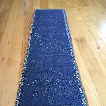 I used L019 Insignia Blue to create this table runner.  Using 30 wt rayon thread and my Baby Loc...