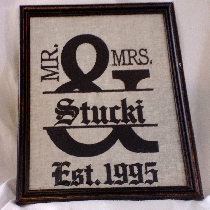 Machine embroidered wedding sign on linen.