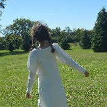 A Bobka Baby original made in linen and trimmed with venice lace. Long sleeved dress and pants.